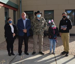Merrick presents Mayor Terry Furlong with face masks for the City